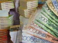 Депутаты возмущены высокой стоимостью школьных учебников в Казахстане