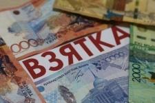 Бывший сотрудник криминальной полиции выплатит пятимиллионный штраф за взятку в 100 тысяч тенге