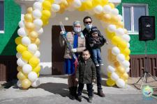 Переселенцы из трудоизбыточных регионов отметили новоселье в Ленинском
