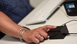 Казахстанцы смогут получать услуги в ЦОНе по отпечатку пальцев