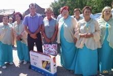 Телевизор в подарок получила семья жителей села Павлодарское за роскошные цветники