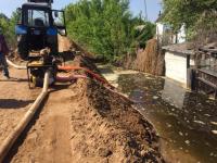 В Аксу подтопило огороды и хозпостройки в четырех домах на улице Набережной